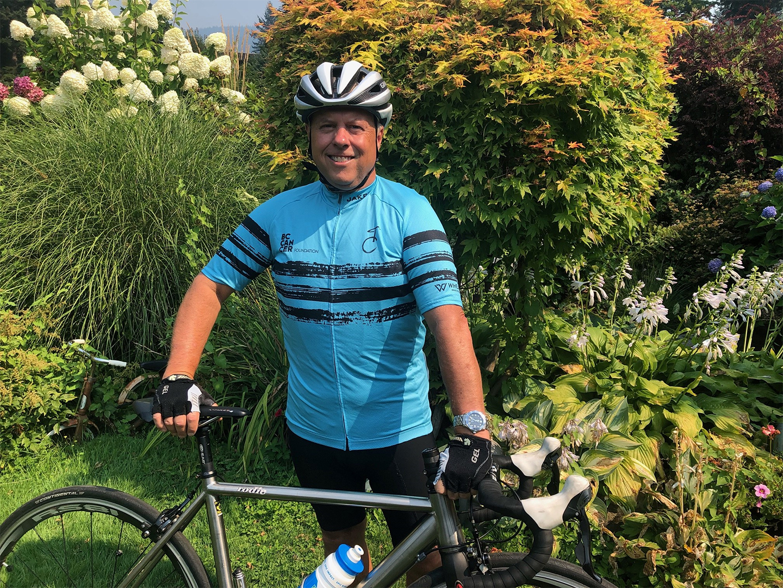 Brian Benson wearing a Tour de Cure jersey